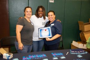 Lisa and Erin with Commissioner Siplin at a back to school event.